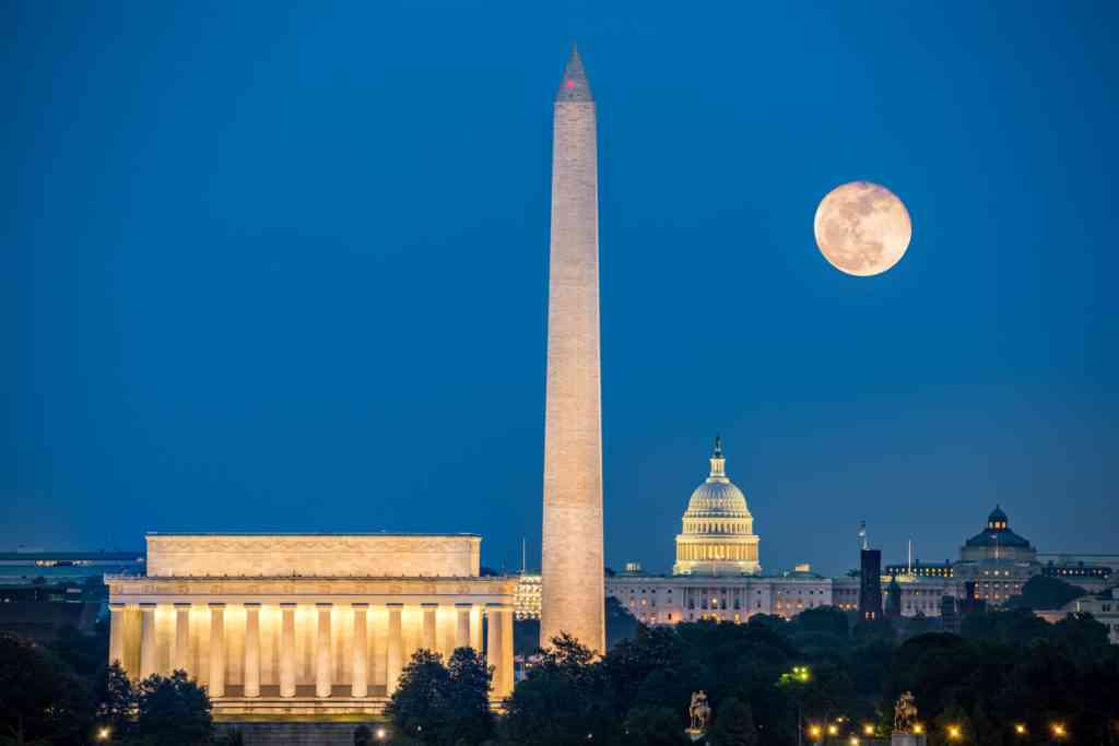 full moon over iconic Washington, D.C. landmarks